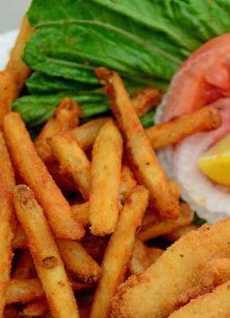 fattening: crispy french fries and fattening food Stock Photo