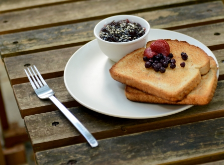 toast with berries and jam for breakfast photo