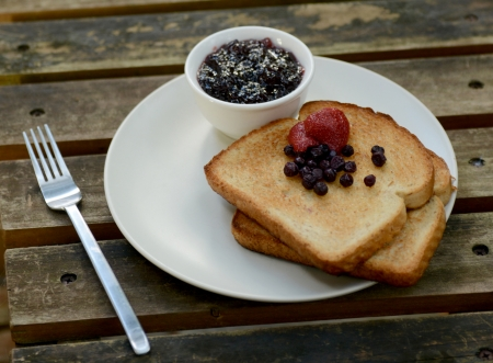 berry toast breakfast on wood photo
