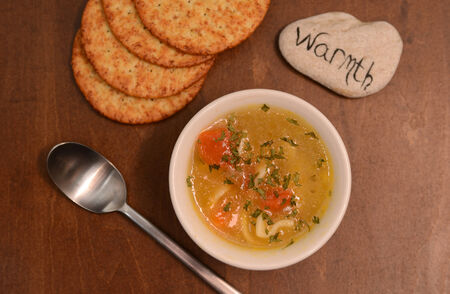 the warmth: warmth and bowl of soup for comfort food Stock Photo