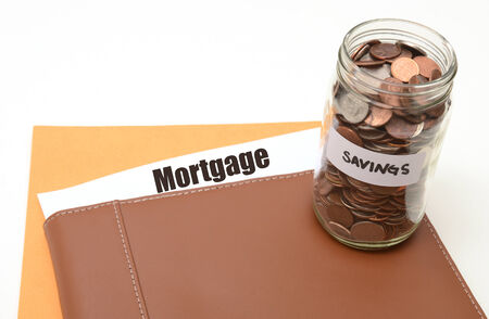 saving money on mortgage or real estate concept