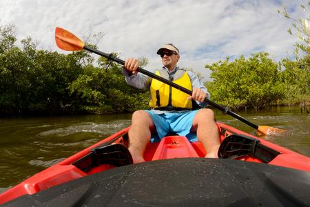 man in red kayak in Florida