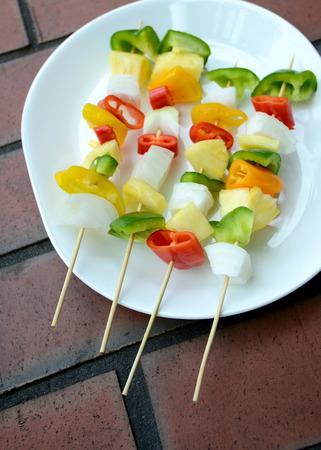 vegan meal of vegetable kebabs on skewers