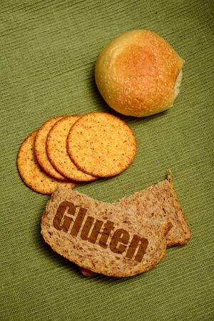 gluten concept with bread, crackers and a roll
