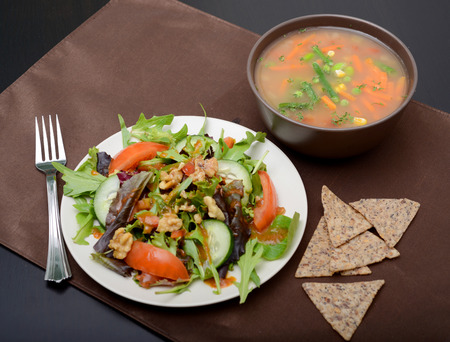 the corn salad: vegetable soup, salad and chips for lunch Stock Photo