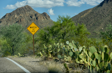 tuscon: watch for ice sign on road in hot desert climate in arizona Stock Photo