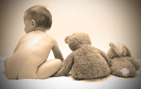 innocence: Innocence of childhood with baby posing with stuffed animals