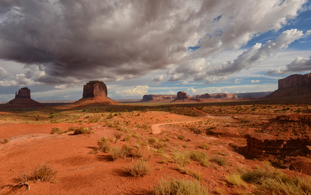 Dirt Road in Monument Valley desert on the Utah and Arizona state border