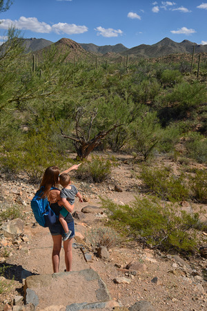 tuscon: mother hiking with child in southwest and showing him the beauty of the desert Stock Photo