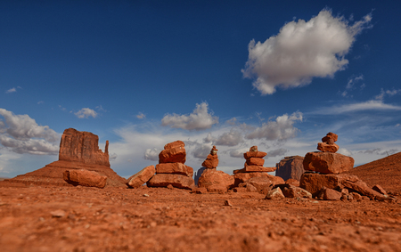 cairns: Desert meditation and line of prayer rocks or cairns near famous Monument Valley desert landmark