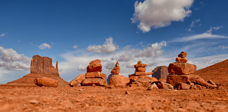 american native: Stacks of prayer rocks or cairns lined up in Monument Valley desert