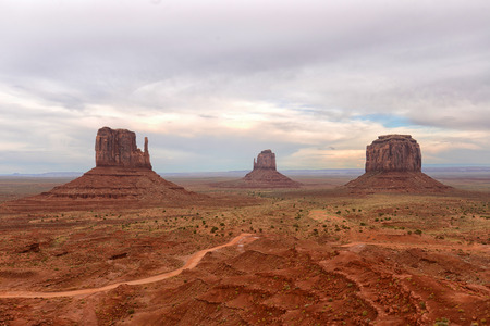 dreary: Monument Valley on a dreary day with a dirt road in the foreground