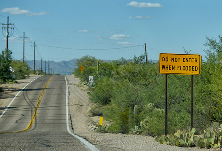tuscon: do not enter when flooded sign in arizona