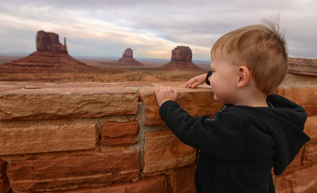 native american baby: Toddler travel concept with child at Monument Valley looking at the beauty of the desert