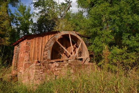 Rustic and vintage water mill in summertime
