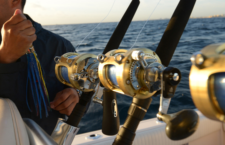 sea fishing: Man holding lure while deep sea saltwater fishing