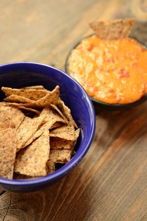 comfort food: Vegan comfort food with tortilla chips and a cheese dip for nachos Stock Photo