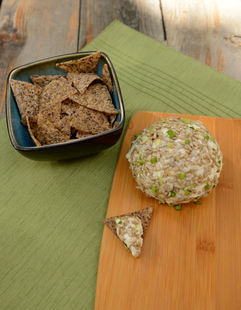 barnwood: Gourmet Vegan Cheese Ball for a festive appetizer on rustic table