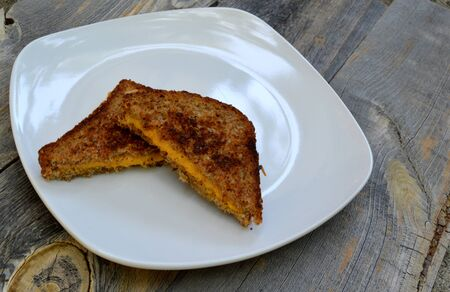 comfort food: Vegan comfort food with a vegan grilled cheese on a wooden background
