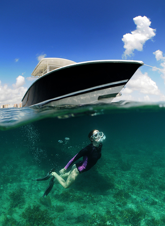 skin diving: Underwater image of woman snorkeling near a boat