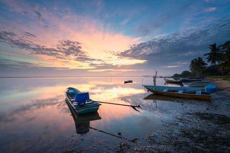 Fisherman boat dock at beach during sunrise at Jubakar Kelantan, Malaysia