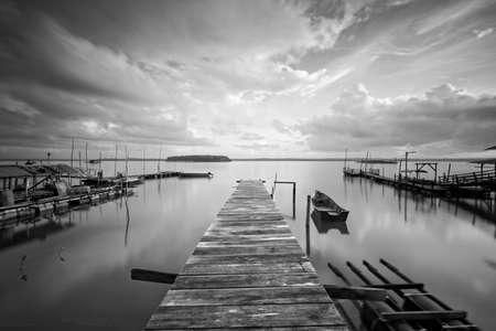 sg: Black & White wooden fishermen jetty at Sg Tiram Johor, image may be blurry because long exposure Stock Photo