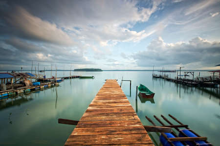 sg: yellow wooden fishermen jetty at Sg Tiram Johor, image may be blurry because long exposure