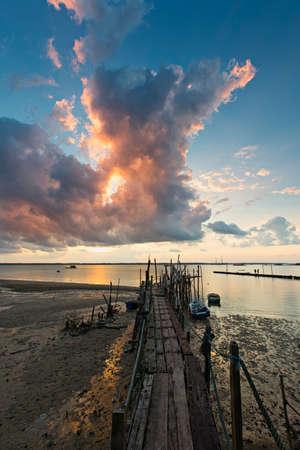 kampung: small wooden fishermen jetty during cloudy sunset at Kampung Teluk Sengat, Kota Tinggi, Johor