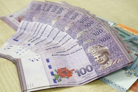 Malaysia currency of Malaysian ringgit banknotes .Paper money of ten ringgit, twenty ringgit, fifty ringgit and one hundred notes on closeup. Financial concept. selective focus and soft focus