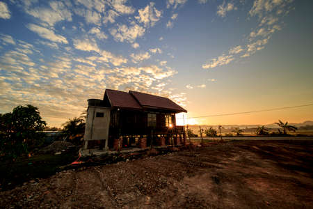 A general view of traditional wooden Malay house with an exciting glimpse into traditional Malaysian culture and architecture during bright sunset and sunburst Editorial