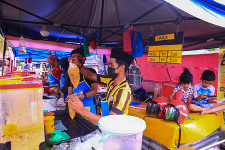 Kedah,Malaysia-April 21 2021 : Selective focus image with noise effect buyers visitor at street bazaar follow the SOP before enter bazar ramadan year of outbreak corona virus.