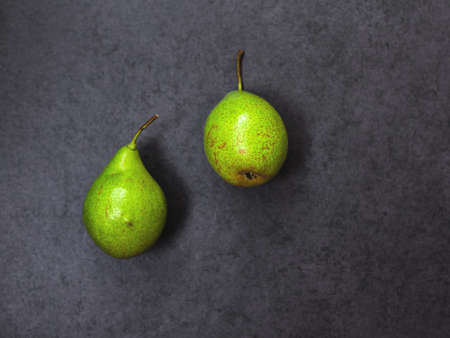 autmn: Two pears on a  gray stone background, top view
