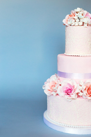 Cake decorated with roses on a blue background Stock Photo