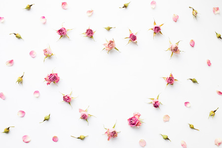 Frame Heart from the petals of dried roses and buds Stock Photo
