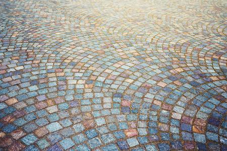 Granite cobble stoned pavement background. Stock Photo