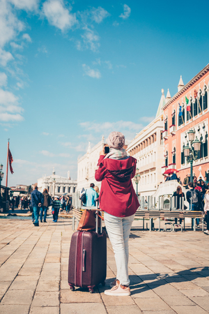 Woman photographing sights of Venice. Stok Fotoğraf - 100358050