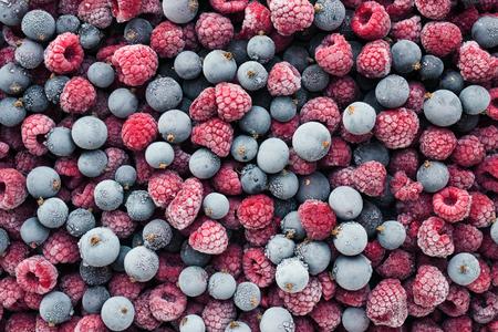 Frozen berries top view. Raspberries and black currant.