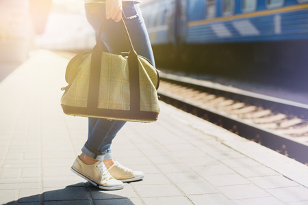 Woman holding a bag at a train station