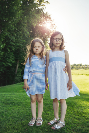 Two girls standing on the field. Stockfoto