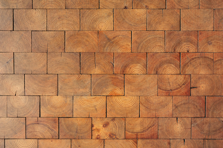 Natural wooden floor texture. Cross cut lumber blocks, top view.