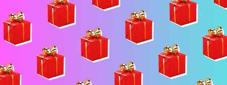 Red gift boxes with golden bow on trendy background. Minimal styled Christmas and holiday concept. Banner for website.