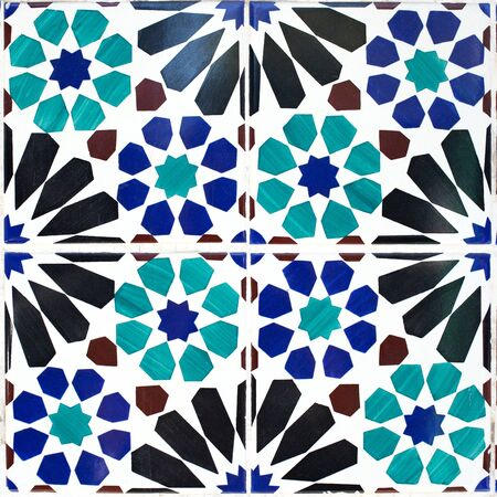 Traditional ornate portuguese decorative tiles azulejos in white, green, blue and black colours. Stock Photo