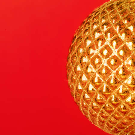 Abstract golden glowing halfsphere on red background.