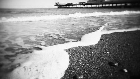 spring tide: Incoming tide on an english beach Stock Photo