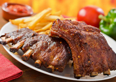 baked potato: Pork Baby Back Ribs Stock Photo