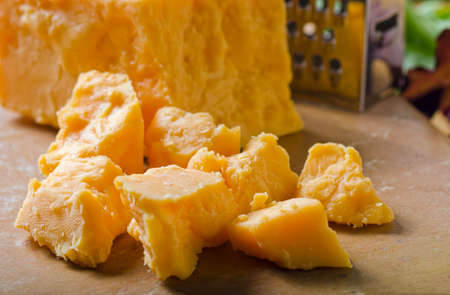 cheddar cheese: A grouping of crumbled cheddar cheese.