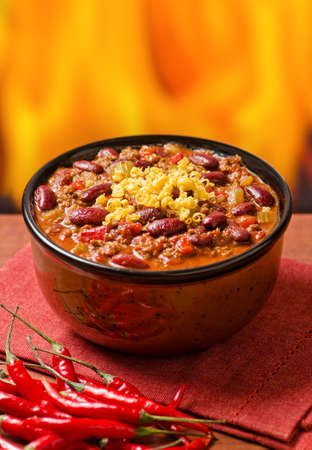 A hearty bowl of chili con carne with hot peppers. photo