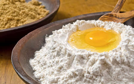 provisions: A bowl of flour with egg well.