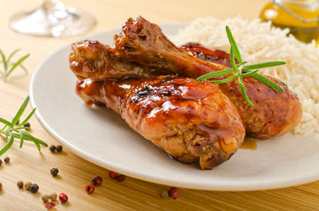 chicken leg: Barbecued chicken legs with white rice.