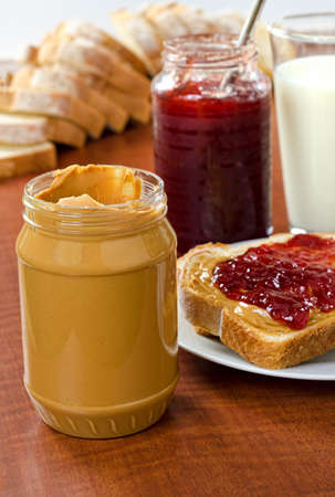 peanut butter and jelly sandwich: Peanut butter and jelly bottles with bread and a glass of milk. Stock Photo